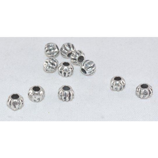 Petit perle en métal