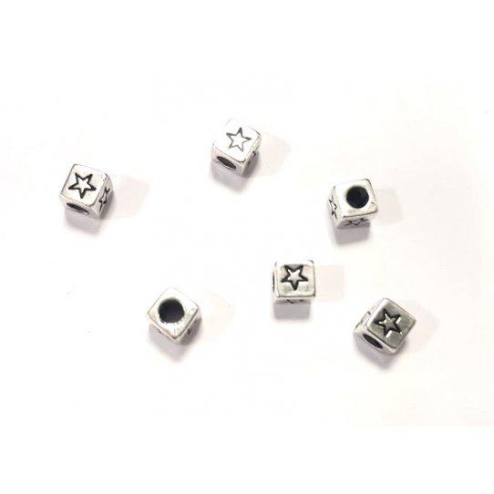 Intercalaire traversant cube avec motif étoile